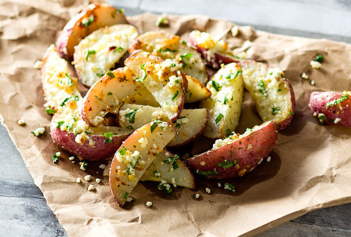 GARLIC ROASTED POTATOES WITH COTIJA