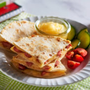Make and share this Cheesy Hot Dog Quesadilla. Both kid and adult approved.