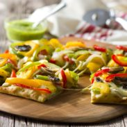 The best pizza is homemade. This Pesto Veggie Pizza recipe is quick, easy and full of flavor!